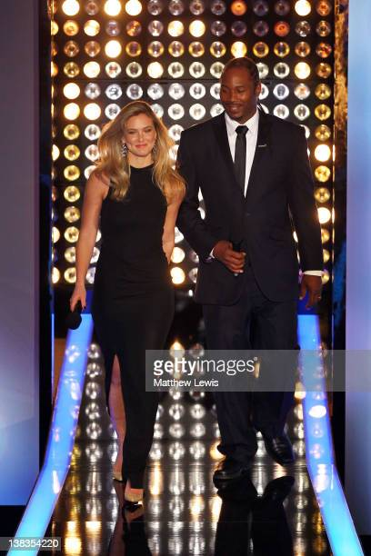 Model Bar Refaeli and Boxer Lennox Lewis walk on stage at the 2012 Laureus World Sports Awards at Central Hall Westminster on February 6 2012 in...