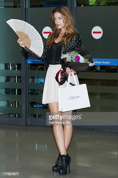 Model Barbara Palvin is seen upon arrival as she holds folding fans at the Incheon International Airport on August 26 2013 in Incheon South Korea