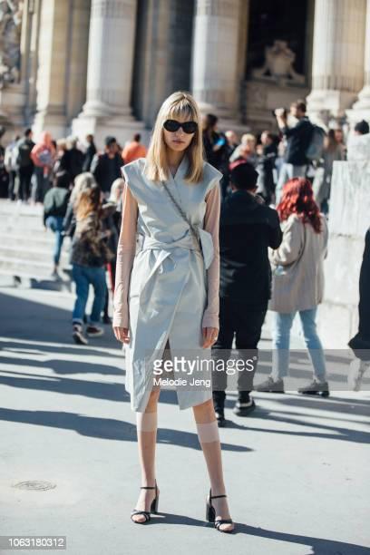 Model Barbora Bruskova exits the Margiela show in a light blue dress sleeves transparent socks and black heels during Paris Fashion Week...