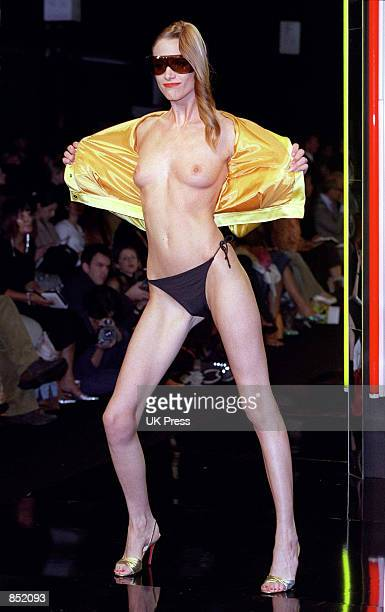 A model bears it all on the runway wearing only the barest of essentials designed by Anthony Symonds September 25 2000 during London Fashion Week in...