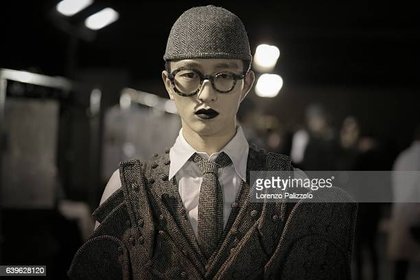 A model beauty backstage detail poses Backstage prior the Thom Browne Menswear Fall/Winter 20172018 show as part of Paris Fashion Week on January 22...