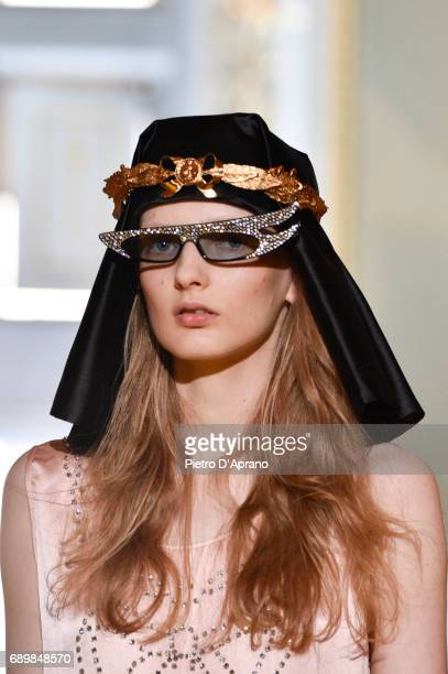 A model beauty detail walks the runway at the Gucci Cruise 2018 show at Palazzo Pitti on May 29 2017 in Florence Italy