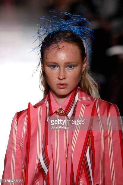 Model, beauty runway detail, walks the runway at the Tiziano Guardini show during the Milan Fashion Week Spring/Summer 2020 on September 18, 2019 in...