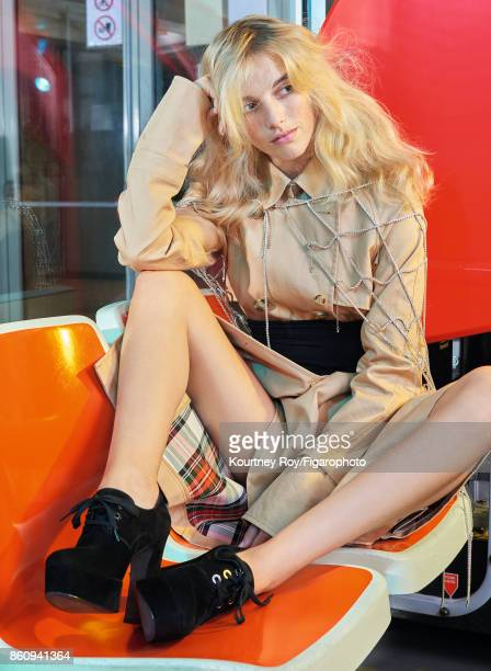 Model Becca Horn poses at a fashion shoot for Madame Figaro on September 7, 2017 in Paris, France. Trench , belt , necklace , shoes . PUBLISHED...
