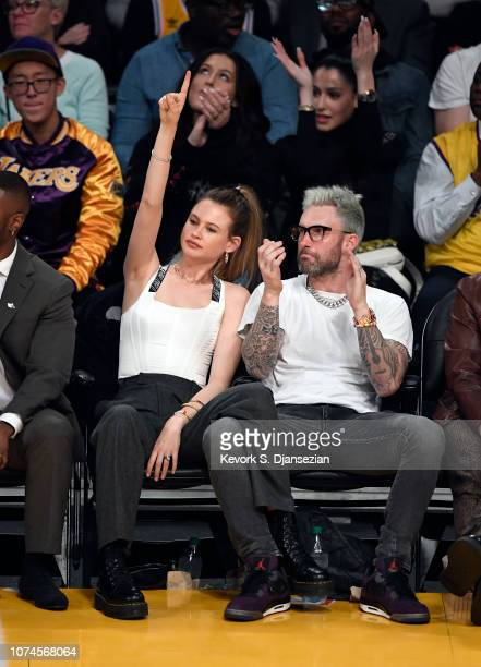 Model Behati Prinsloo and Adam Levine attend a basketball game between New Orleans Pelicans and Los Angeles Lakers at Staples Center on December 21...