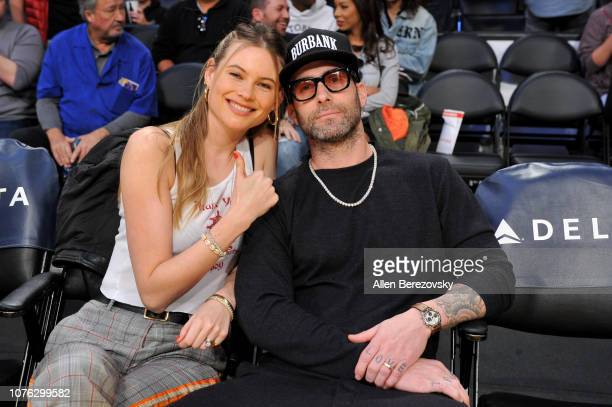 Model Behati Prinsloo and Adam Levine attend a basketball game between the Los Angeles Lakers and the Phoenix Suns at Staples Center on December 02...