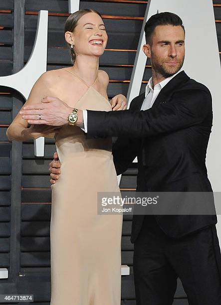 Model Behati Prinsloo and musician Adam Levine arrive at the 2015 Vanity Fair Oscar Party Hosted By Graydon Carter at Wallis Annenberg Center for the...