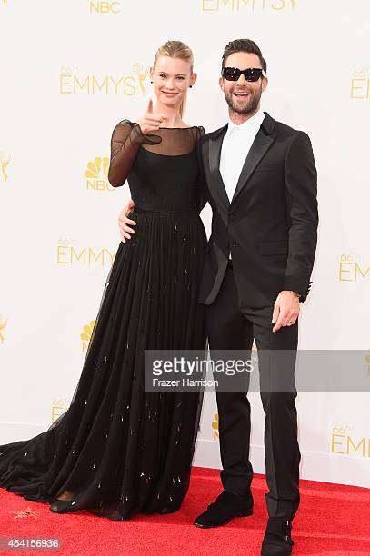 Model Behati Prinsloo and singer Adam Levine attend the 66th Annual Primetime Emmy Awards held at Nokia Theatre LA Live on August 25 2014 in Los...