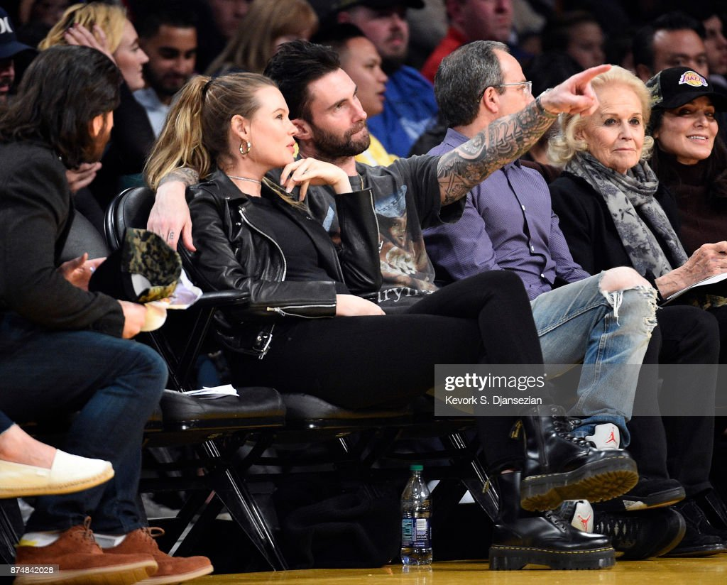Model Behati Prinsloo and singer Adam Levine attend the basketball game between Philadelphia 76ers and Los Angeles Lakers at Staples Center November 15, 2017, in Los Angeles, California.