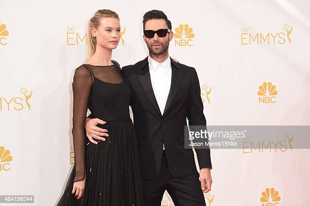 Model Behati Prinsloo and singer/TV personality Adam Levine attend the 66th Annual Primetime Emmy Awards held at Nokia Theatre LA Live on August 25...