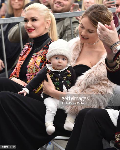 Model Behati Prinsloo, daughter Dusty Rose Levine and singer Gwen Stefani attend the ceremony honoring Adam Levine with star on the Hollywood Walk of...