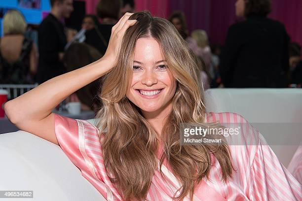 Model Behati Prinsloo prepares backstage before the 2015 Victoria's Secret Fashion Show at Lexington Armory on November 10 2015 in New York City
