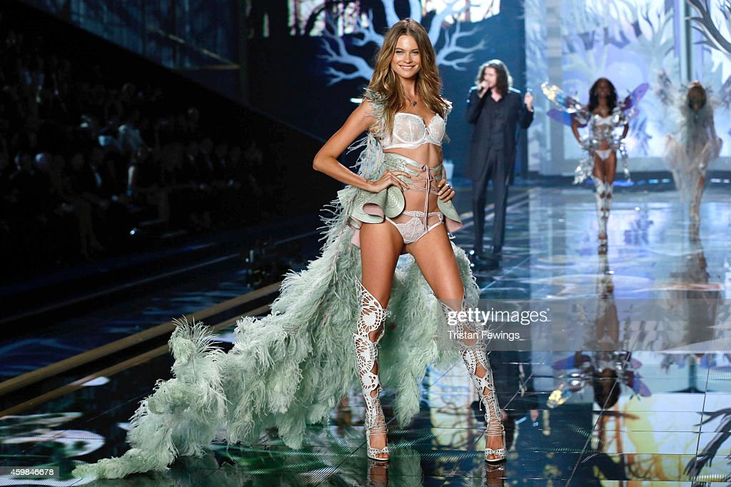Model Behati Prinsloo wears Victoria's Secret Designer Collection Bra and Matching Panty with Swarovski crystals, Leather Corset with Laser Cut Embellishment and Feather Train on the runway at the 2014 Victoria's Secret Runway Show - Swarovski Crystal Looks at Earl's Court Exhibition Centre on December 2, 2014 in London, England.