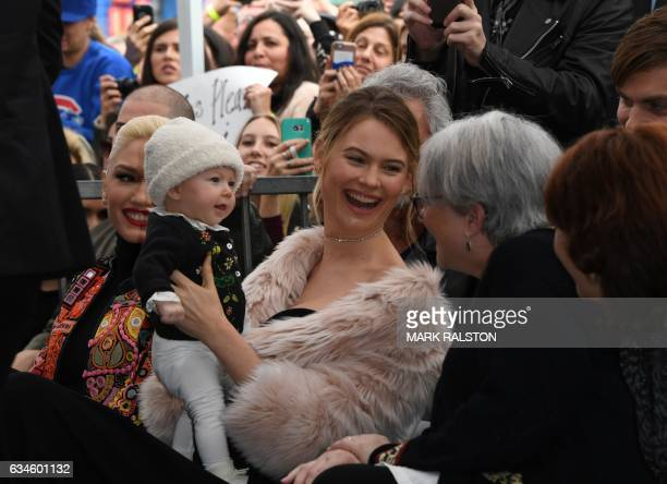 Model Behati Prinsloo , wife of recording artist Adam Levine, with her daughter Dusty Rose, attends a ceremony honoring Levine with a Star on the...