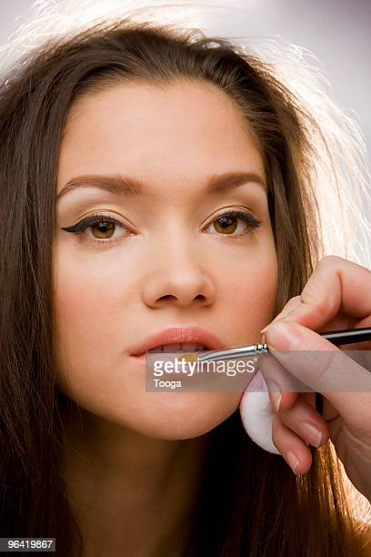 Model behind the scenes getting lipstick
