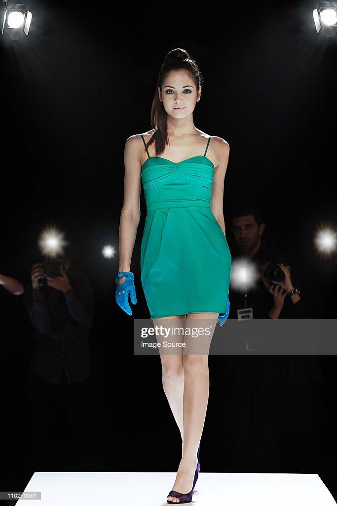 Model being photographed on catwalk at fashion show : Stock Photo