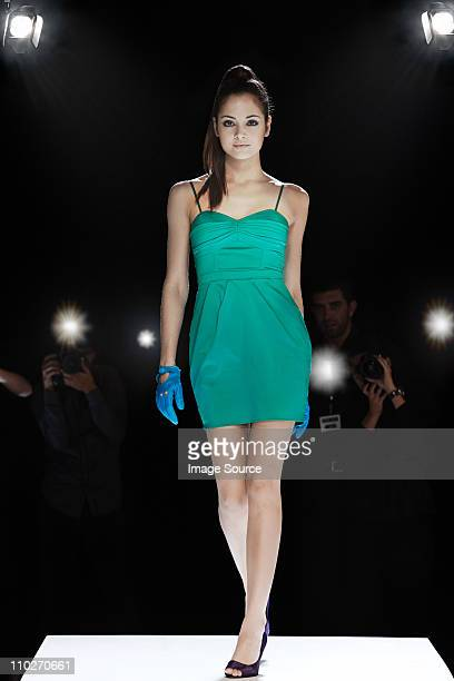model being photographed on catwalk at fashion show - catwalk stage stock pictures, royalty-free photos & images