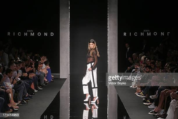 Model Belen Rodriguez walks the runway at the John Richmond show during Milan Menswear Fashion Week Spring Summer 2014 show on June 24 2013 in Milan...