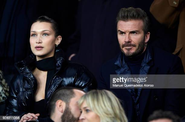 Model Bella Hadid and David Beckham attend the UEFA Champions League Round of 16 Second Leg match between Paris SaintGermain and Real Madrid at Parc...