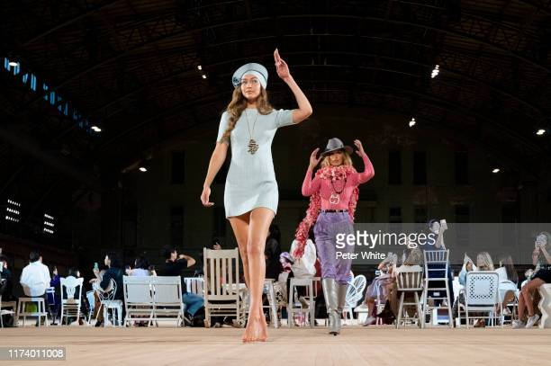 Model Bella Hadid and Gigi Hadid walks the runway during the Marc Jacobs Spring 2020 Runway Show at Park Avenue Armory on September 11, 2019 in New...