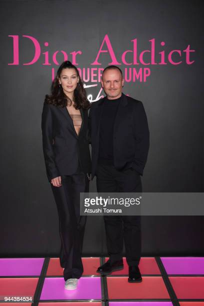 Model Bella Hadid and Makeup artist Peter Philips attends the Dior Addict Lacquer Plump Party at 1 OAK on April 10 2018 in Tokyo Japan