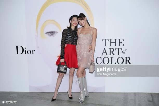 Model Bella Hadid and Model/Actress Kiko Mizuhara attend Dior's The Art of Color Press Preview on April 11 2018 in Tokyo Japan