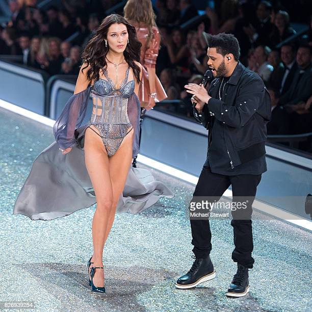 Model Bella Hadid and The Weeknd walk the runway during the 2016 Victoria's Secret Fashion Show at Le Grand Palais in Paris on November 30 2016 in...