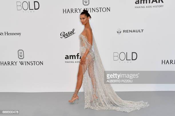 US model Bella Hadid arrives for the amfAR's 24th Cinema Against AIDS Gala on May 25 2017 at the Hotel du CapEdenRoc in Cap d'Antibes France / AFP...