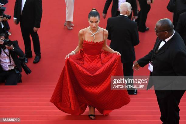 US model Bella Hadid arrives on May 19 2017 for the screening of the film 'Okja' at the 70th edition of the Cannes Film Festival in Cannes southern...