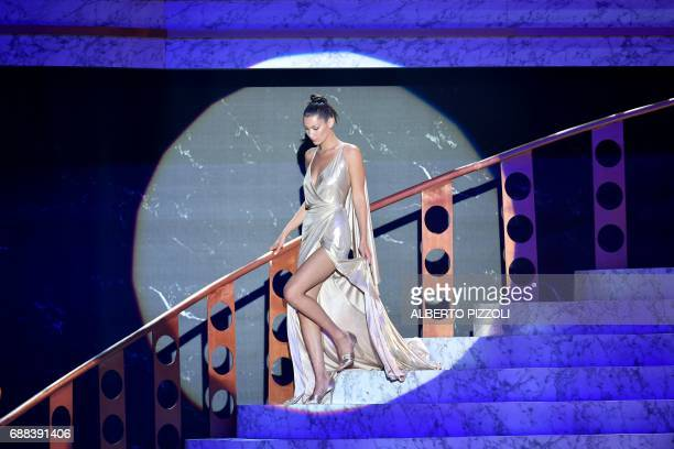 US model Bella Hadid arrives to conduct an auction during the amfAR's 24th Cinema Against AIDS Gala on May 25 2017 at the Hotel du CapEdenRoc in Cap...