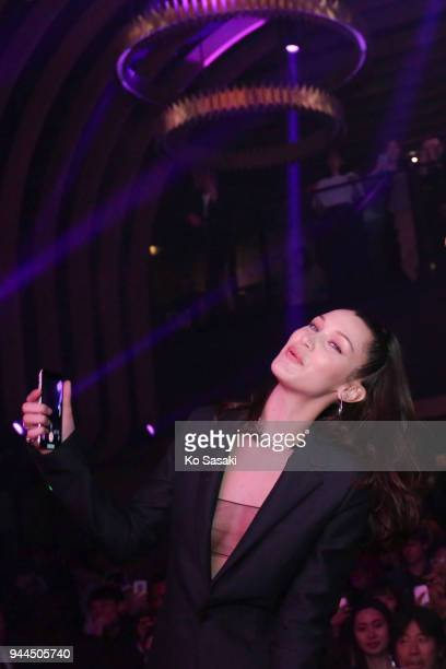 Model Bella Hadid attends the Dior Addict Lacquer Plump Party at 1 OAK on April 10 2018 in Tokyo Japan