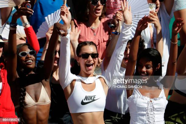 US model Bella Hadid attends the final tennis match between Romania's Simona Halep and Latvia's Jelena Ostapenko at the Roland Garros 2017 French...