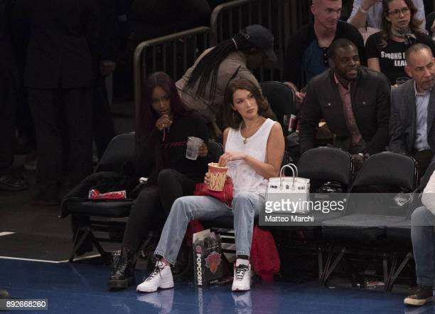 Model Bella Hadid attends the game between the Los Angeles Lakers and the New York Knicks at Madison Square Garden on December 12 2017 in New York...