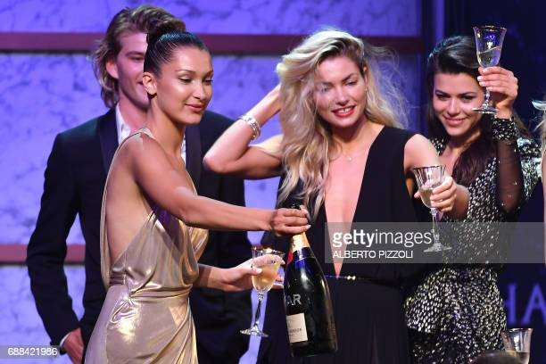 TOPSHOT US model Bella Hadid Australian model Jessica Hart New Zealander model Georgia Fowler attend the amfAR's 24th Cinema Against AIDS Gala on May...