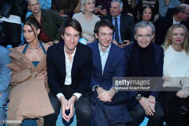 Model Bella Hadid, CEO of Rimowa, Alexandre Arnault, Frederic Arnault, Owner of LVMH Luxury Group Bernard Arnault and Louis Vuitton's executive vice...