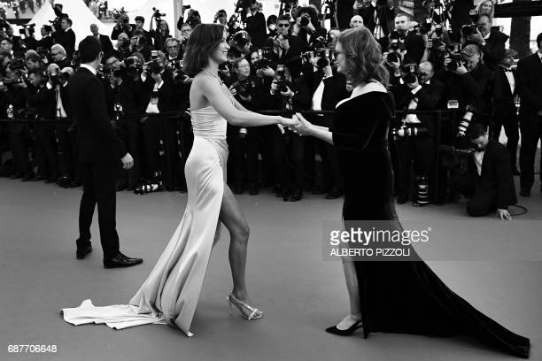 US model Bella Hadid is greeted by US actress Susan Sarandon as she arrives on May 17 2017 for the screening of the film 'Ismael's Ghosts' during the...