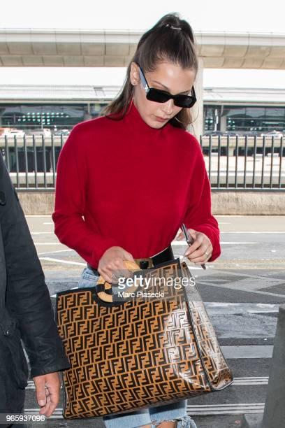 Model Bella Hadid is seen at CharlesdeGaulle airport on June 2 2018 in Paris France