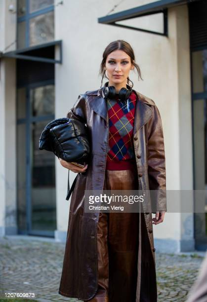 Model Bella Hadid is seen wearing brown leather coat and pants, checkered jumper outside Max Mara during Milan Fashion Week Fall/Winter 2020-2021 on...