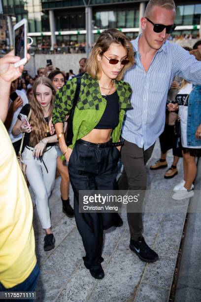 Model Bella Hadid is seen wearing green plaid jacket cropped top black pants outside the Alberta Ferretti show during Milan Fashion Week...