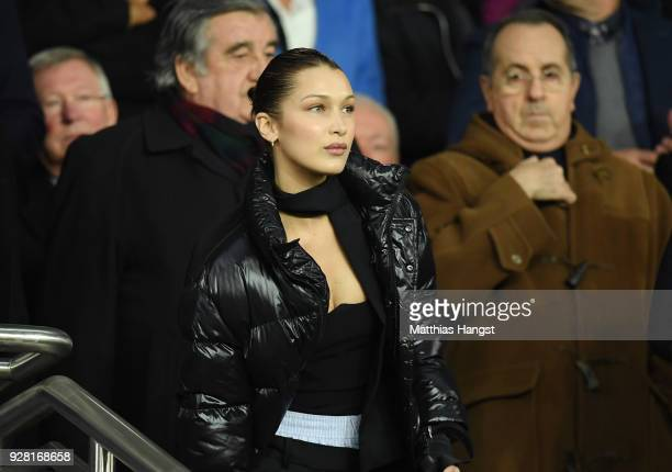 Model Bella Hadid looks on from the stands prior to the UEFA Champions League Round of 16 Second Leg match between Paris SaintGermain and Real Madrid...