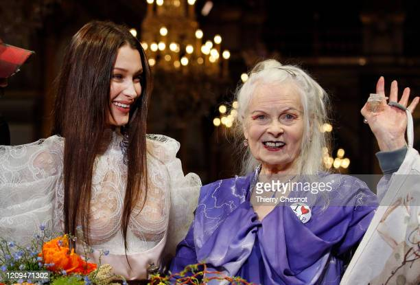 Model Bella Hadid model and British designer Vivienne Westwood pose at the end the Vivienne Westwood show as part of the Paris Fashion Week...