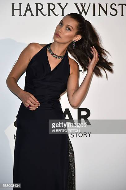US model Bella Hadid poses as she arrives for the amfAR's 23rd Cinema Against AIDS Gala on May 19 2016 at the Hotel du CapEdenRoc in Cap d'Antibes...