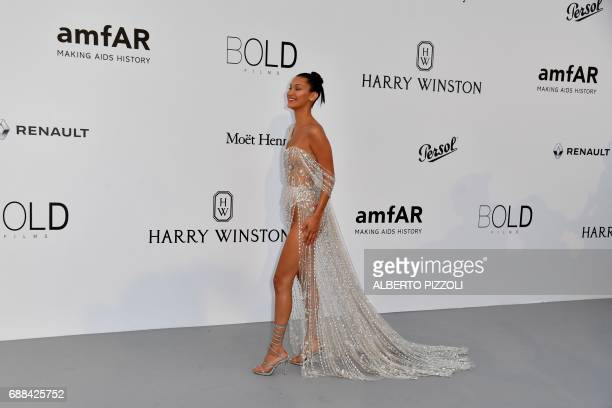 US model Bella Hadid poses as she arrives for the amfAR's 24th Cinema Against AIDS Gala on May 25 2017 at the Hotel du CapEdenRoc in Cap d'Antibes...