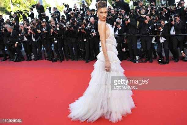 US model Bella Hadid poses as she arrives for the screening of the film Rocketman at the 72nd edition of the Cannes Film Festival in Cannes southern...