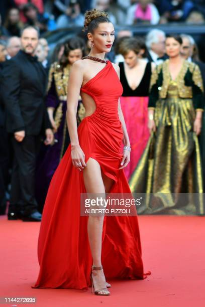 """Model Bella Hadid poses as she arrives for the screening of the film """"Dolor Y Gloria """" at the 72nd edition of the Cannes Film Festival in Cannes,..."""