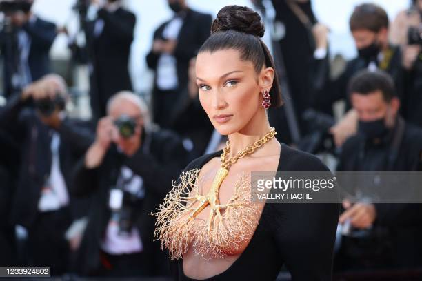 """Model Bella Hadid poses as she arrives for the screening of the film """"Tre Piani"""" at the 74th edition of the Cannes Film Festival in Cannes, southern..."""