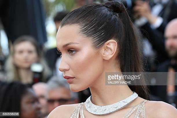 US model Bella Hadid poses as she arrives on May 11 2016 for the opening ceremony of the 69th Cannes Film Festival in Cannes southern France / AFP /...