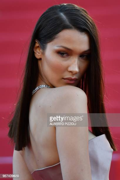 US model Bella Hadid poses as she arrives on May 11 2018 for the screening of the film 'Ash is Purest White ' at the 71st edition of the Cannes Film...