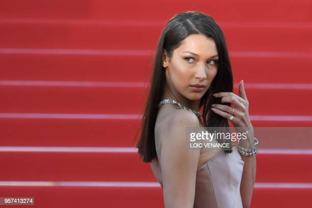 "Model Bella Hadid poses as she arrives on May 11, 2018 for the screening of the film ""Ash is Purest White "" at the 71st edition of the Cannes Film..."