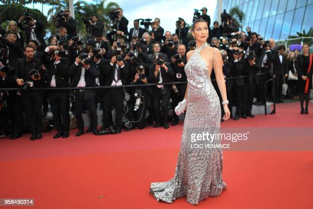 """Model Bella Hadid poses as she arrives on May 14, 2018 for the screening of the film """"BlacKkKlansman"""" at the 71st edition of the Cannes Film Festival..."""